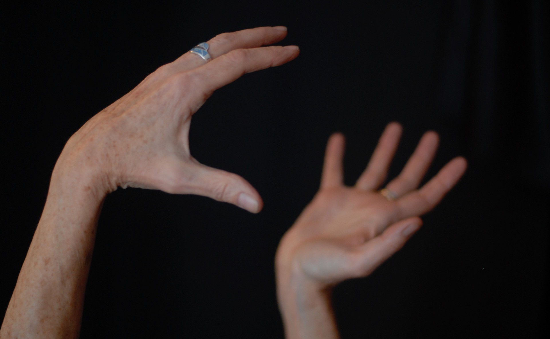 A storyteller's hands grasp an unseen object, illustrating nonfiction narratives, which are complex and embedded