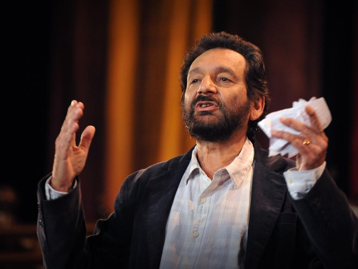 Shekhar Kapur gestures while telling a story, illustrating when it is that stories help us heal