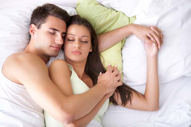 Couple in bed illustrating that enduring bonds tend to form in sexual relationships